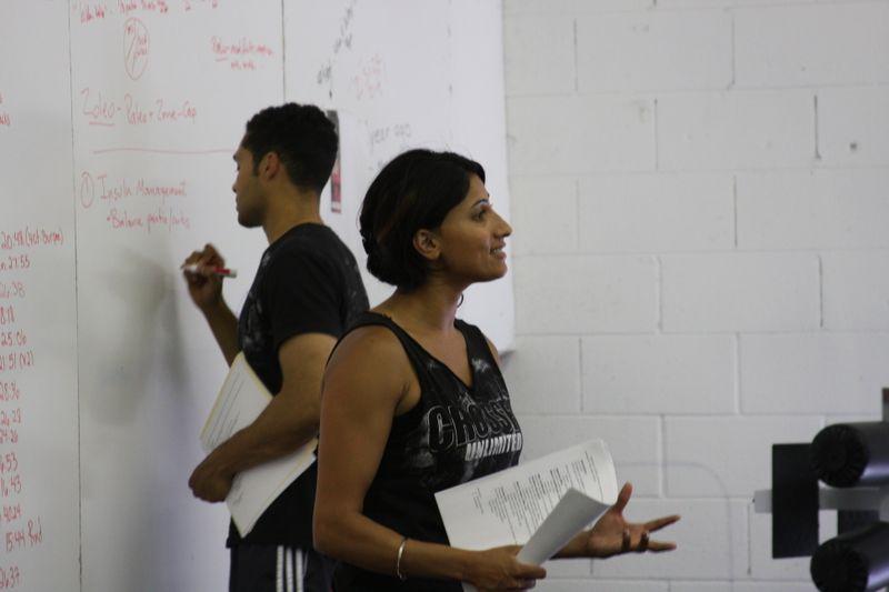 Ritu and AJ leading a seminar